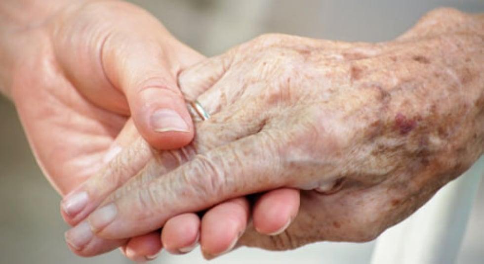 Demens - illustrasjon to hender som holder hverandre